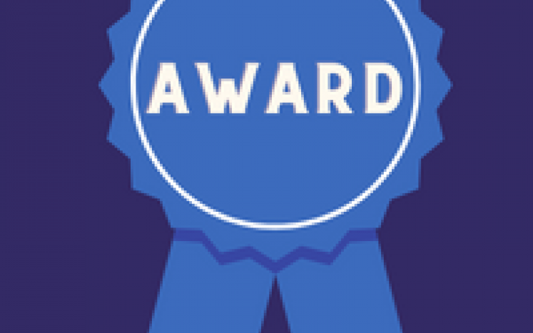 A bright blue ribbon on a royal blue background. The ribbon says award in white letters.