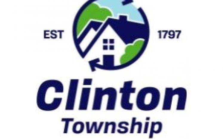 Clinton Township logo with trees, houses and sky surrounded by rotating arrows.